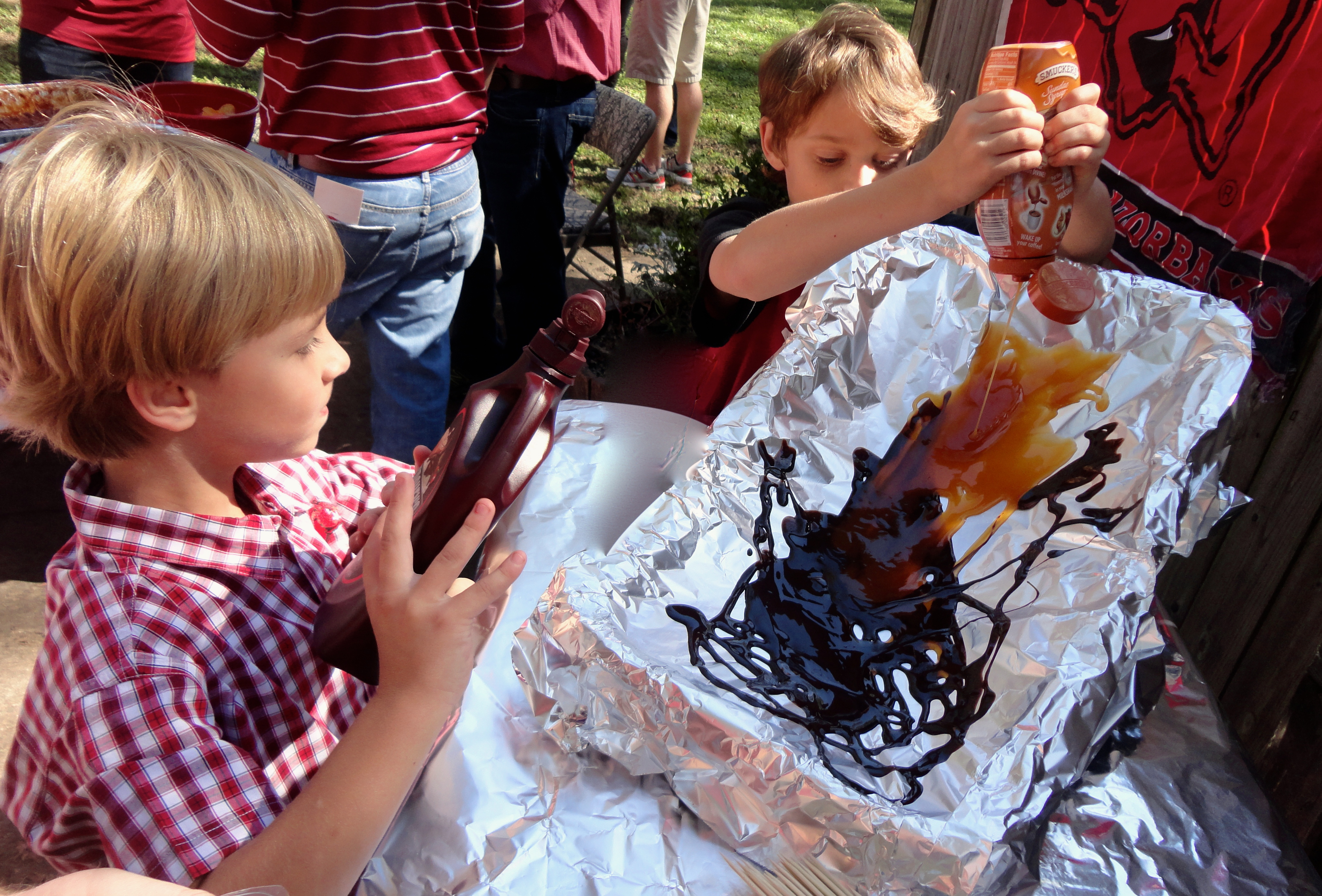 Two younger snouts helping create the mudslide for our skewered apples and marshmallows