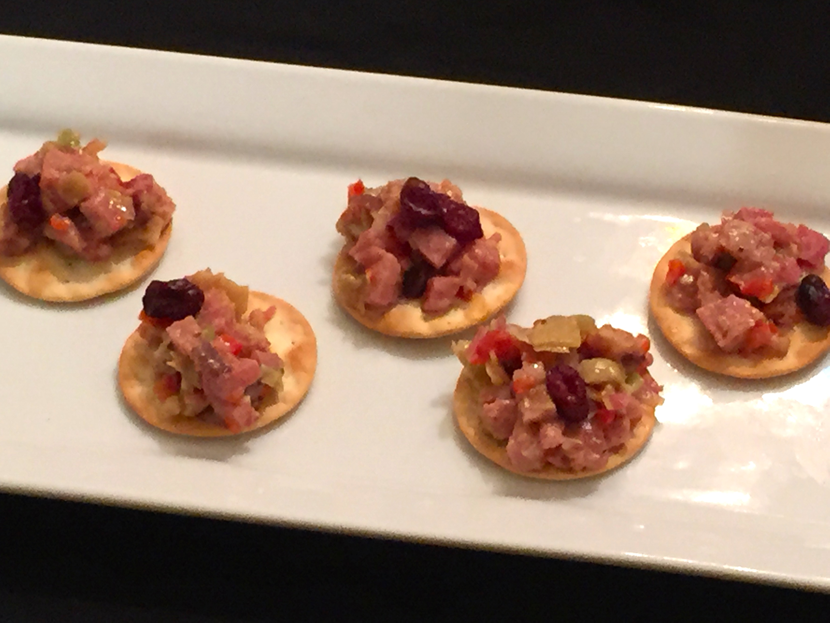 ham, artichoke and cranberry salad on water crackers