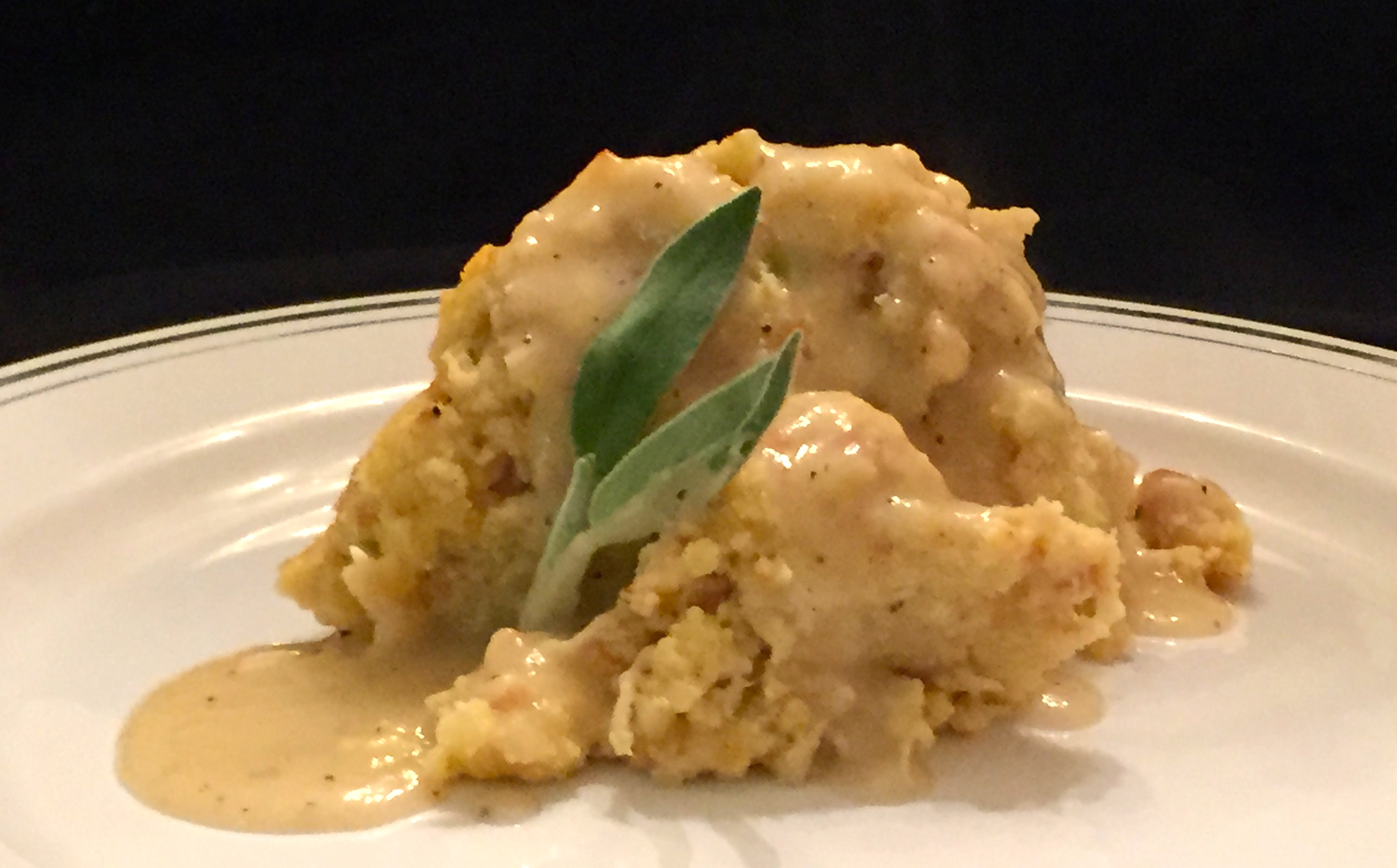 chicken and cornbread dressing topped with rosemary and sage infused gravy