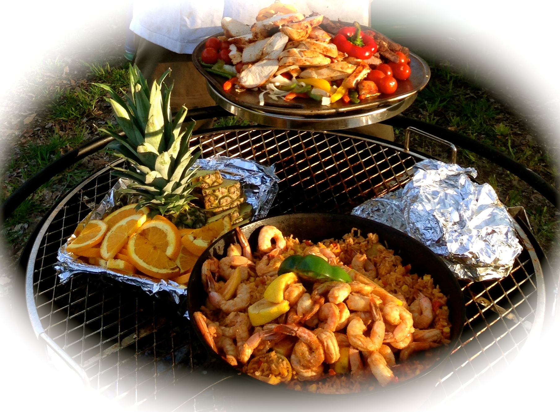 grilled Mexican feast of chicken and shrimp fajitas and spanish rice