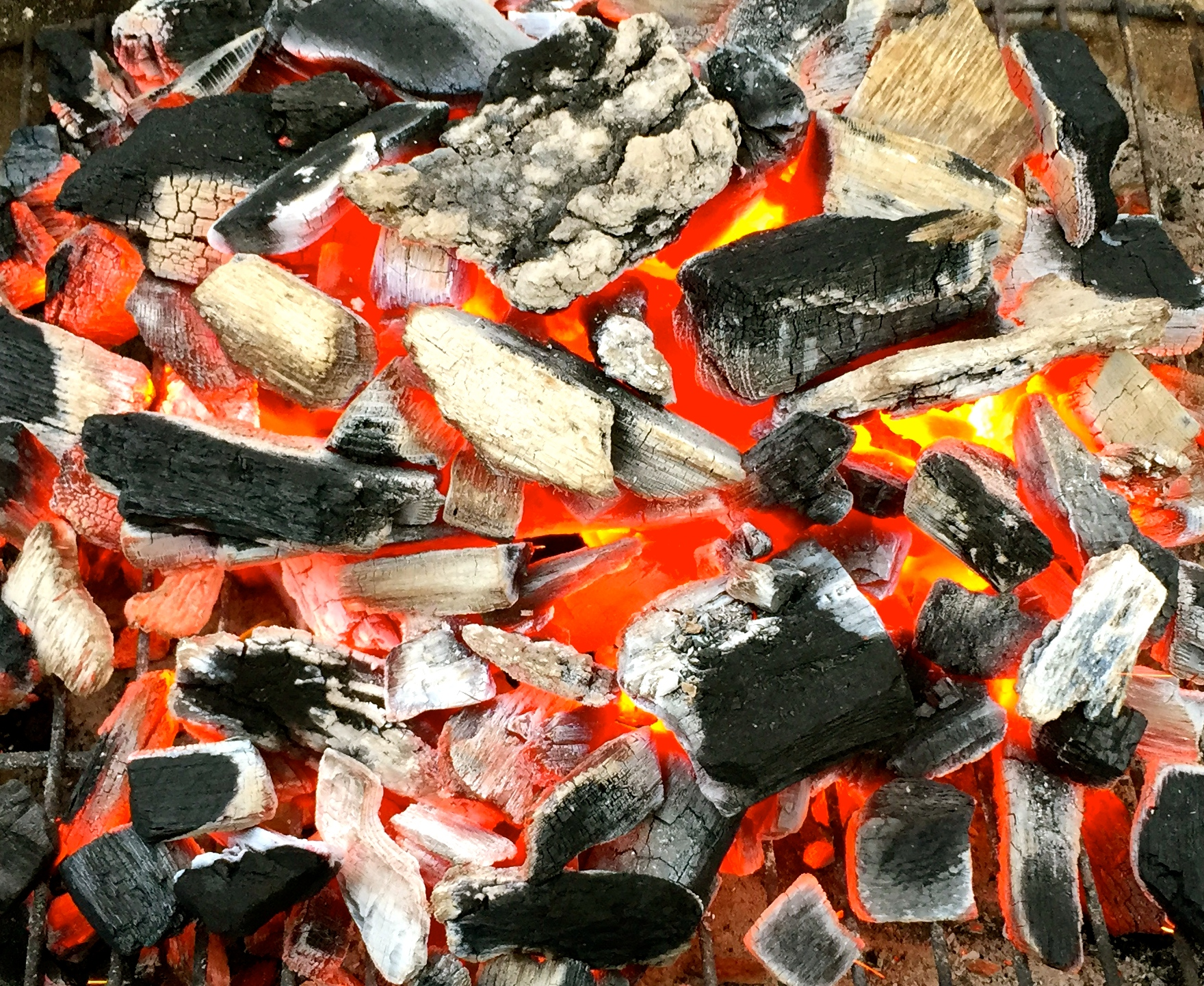 glowing embers of lump charcoal
