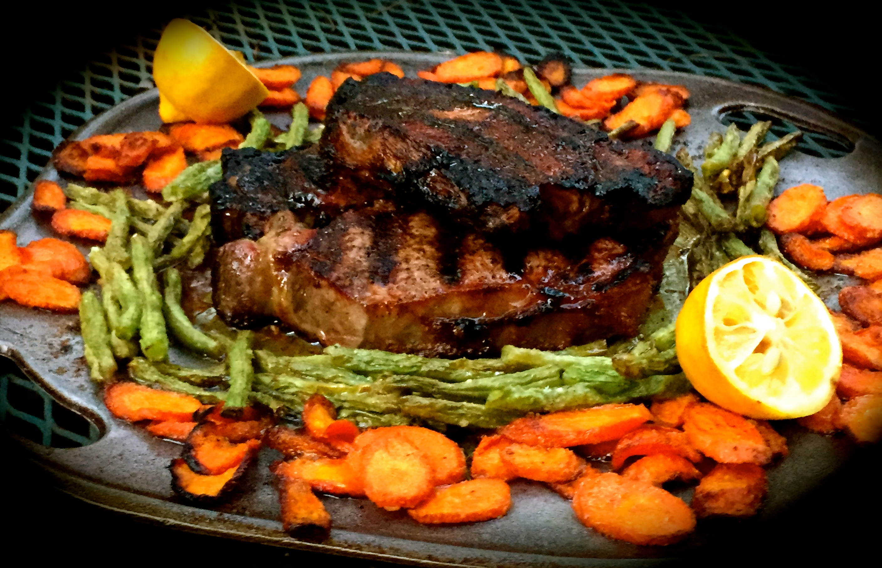 new york strip steak with sautéed carrots and green beans
