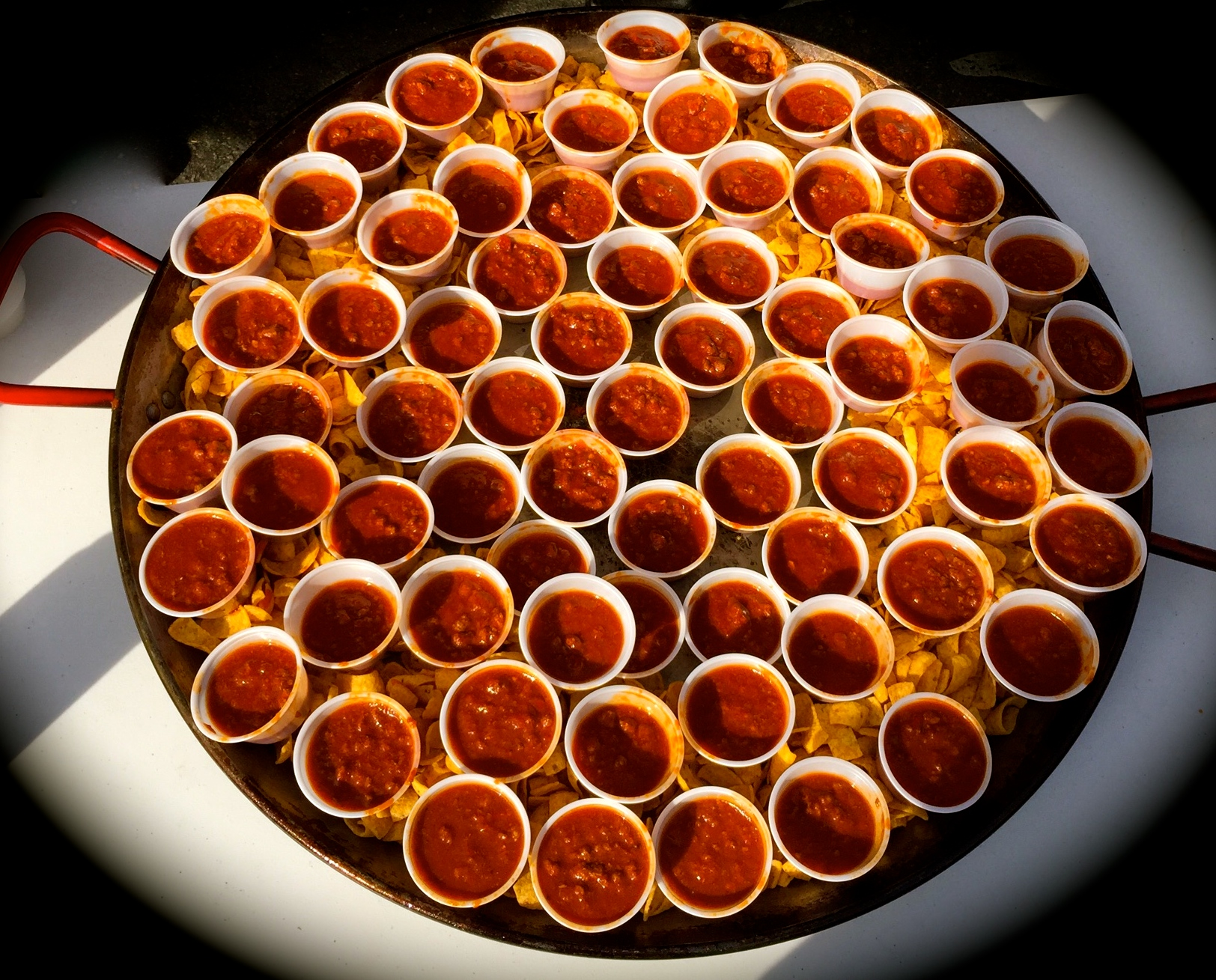 Thimbles full of chili served in the paella pan