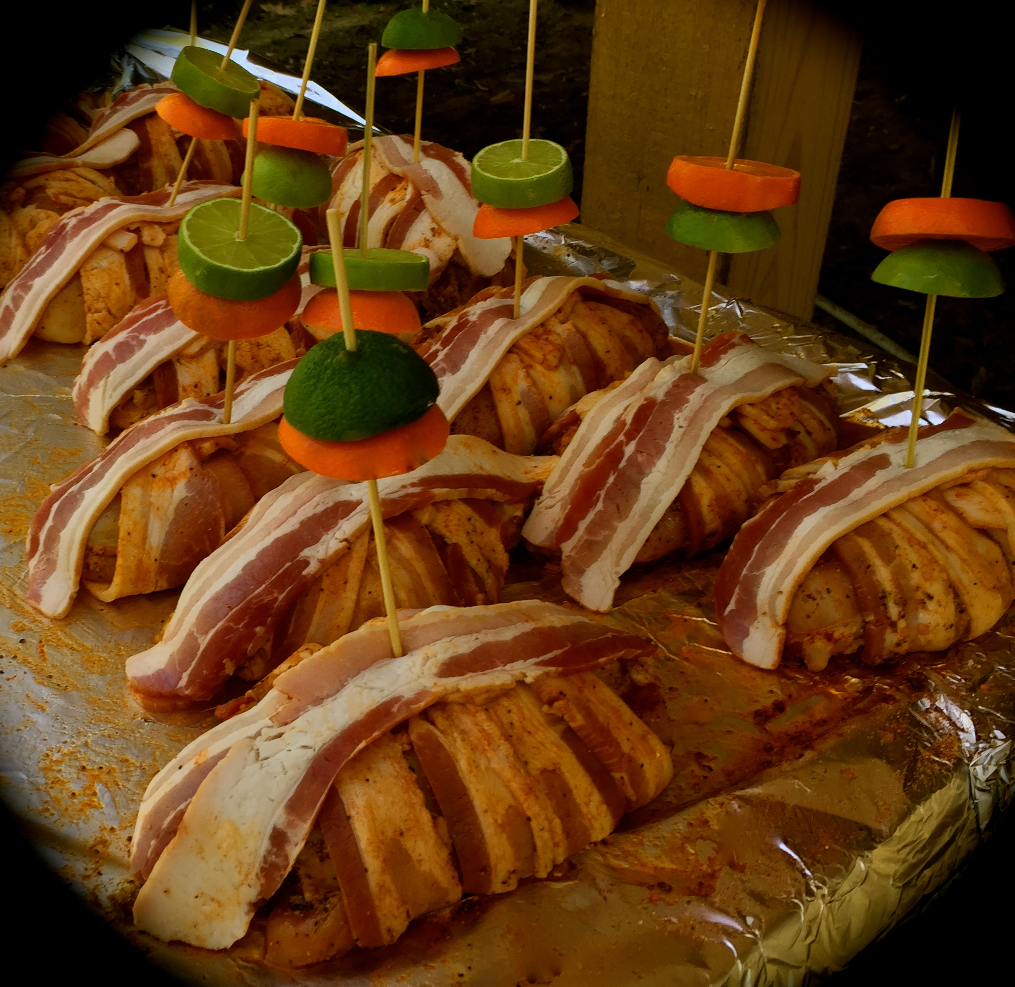 Bacon wrapped chicken bricks adorned with citrus umbrellas