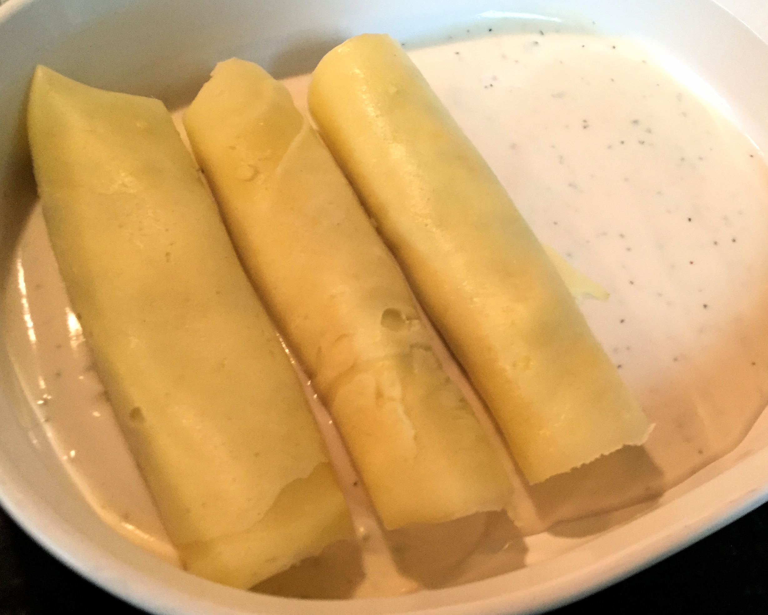 manicotti with sauce in pan